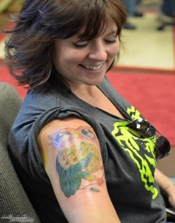 Tattoo Artist Covers-Up Reminders of a Troubled Past