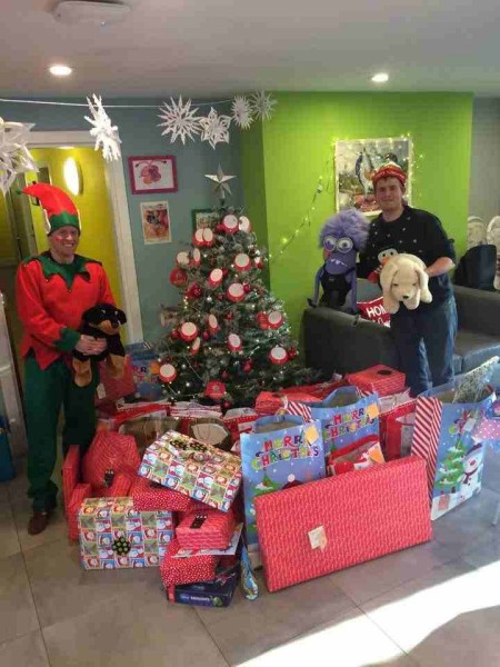 Santa's little helpers make special delivery to sick children on Christmas Day