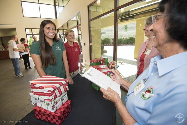 Hurricane Harvey Survivors Deliver Early Christmas Gifts to Barbudan Children