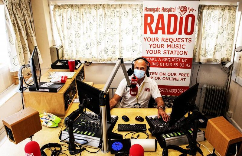 A cupboard under the stairs and a weekly sing-along podcast: just some of the innovative solutions that Hospital Radio volunteers across the country have found to continue broadcasting during the Covid-19 pandemic.