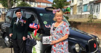 WWII Veteran Harry Rawlins in front of a black cab