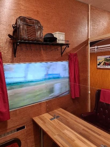 Award-Winning TV and Film Set Builder Delights Care Home Residents With Train Carriage to Help Them Meet Family Safely